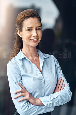 Buy stock photo Shot of a confident businesswoman posing outside the office