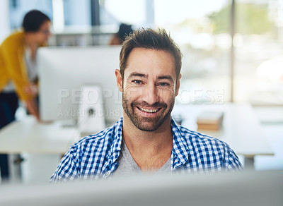 Buy stock photo Portrait of a businessman working on a computer in a modern office