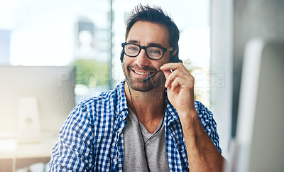 Buy stock photo Cropped shot of a support agent working in a modern office