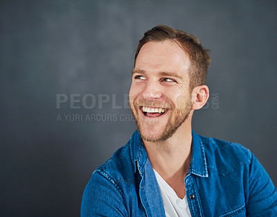 Buy stock photo Cropped shot of a young businessman sitting against a grey background