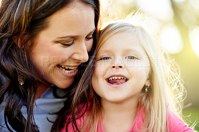 Buy stock photo Portrait of a mother and her young daughter bonding at the park