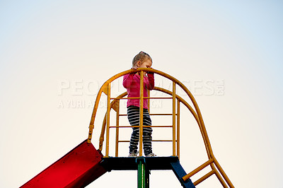 Buy stock photo Full length shot of a little girl on a slide in the park