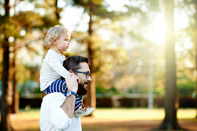 Buy stock photo Shot of a father and his young daughter playing together at the park