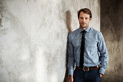 Buy stock photo Portrait of a businessman in a shirt and tie leaning against a wall