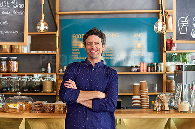 Buy stock photo Portrait of man standing in front of the counter in a cafe
