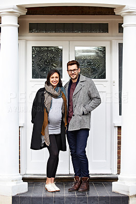 Buy stock photo Portrait of a pregnant woman and her husband standing on their front porch