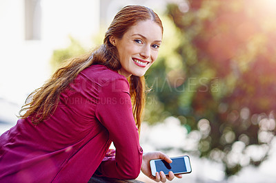 Buy stock photo Portrait of a young woman waiting for a call while standing outside