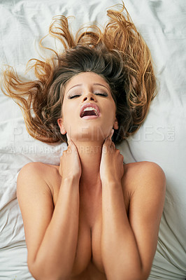 Buy stock photo Shot of a sexy young nude woman experiencing a pleasurable moment at home