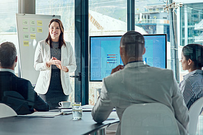 Buy stock photo Cropped shot of a businesswoman delivering a presentation in the boardroom