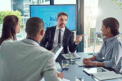 Buy stock photo Shot of a group of businesspeople having a meeting in the boardroom