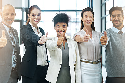 Buy stock photo Portrait of a diverse team of colleagues giving you thumbs up at work