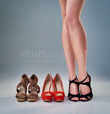 Buy stock photo Cropped studio shot of a woman's feet as she tries on shoes