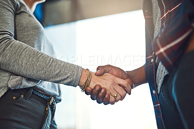 Buy stock photo Closeup shot of businesspeople shaking hands in an office