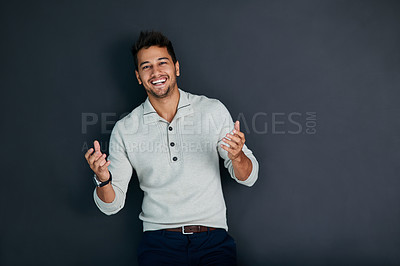 Buy stock photo Studio shot of a handsome young man against a dark background