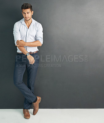 Buy stock photo Studio shot of a relaxed young businessman