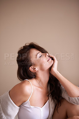 Buy stock photo Shot of a gorgeous young woman posing seductively in her bedroom