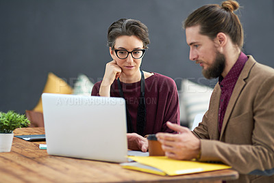 Buy stock photo Cropped shot of a hipster businessman showing his colleague something on his laptop