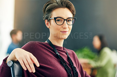 Buy stock photo Portrait of a young businesswoman sitting in a modern office