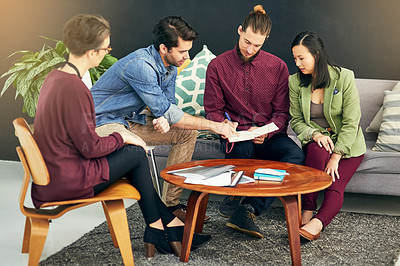 Buy stock photo Shot of a group of young creatives having a meeting in a modern office