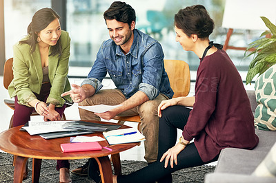Buy stock photo Shot of young creatives having a meeting in a modern office