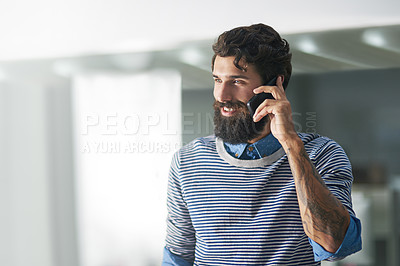 Buy stock photo Cropped shot of creative businessman answering his cellphone in his office