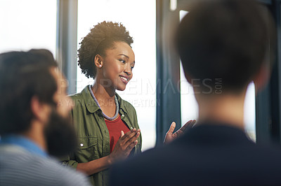 Buy stock photo Cropped shot of creative businesswoman presenting an idea to her colleagues