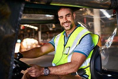 Buy stock photo Portrait of a smiling worker sitting in a forklift in a distribution warehouse