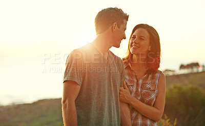Buy stock photo Shot of a happy young couple spending a romantic day outdoors