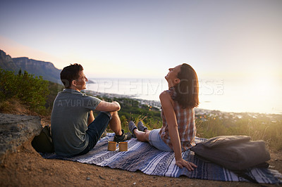 Buy stock photo Shot of a happy young couple enjoying a date outdoors