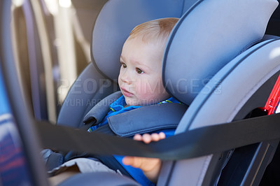 Buy stock photo Cropped shot of an adorable baby boy sitting in a car seat