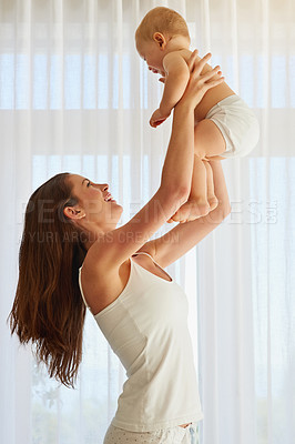 Buy stock photo Cropped shot of a mother spending quality time with her baby boy at home