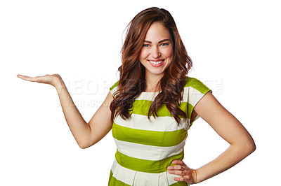 Buy stock photo Studio portrait of a young woman holding up copyspace against a white background