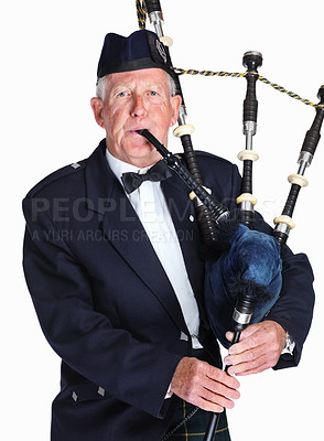Buy stock photo Portrait of a mature highlander with a bagpipes isolated against white