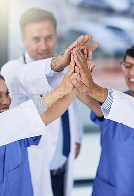 Buy stock photo Closeup shot of medical practitioners giving each other a high five