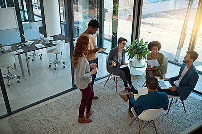 Buy stock photo Shot of a group of creatives having a meeting in a modern office