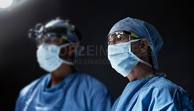Buy stock photo Cropped shot of surgeons performing a surgical procedure