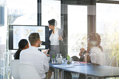 Buy stock photo Cropped shot of a businesswoman giving a presentation in the boardroom
