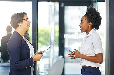 Buy stock photo Cropped shot of two businesswomen meeting outside the boardroom before their presentation