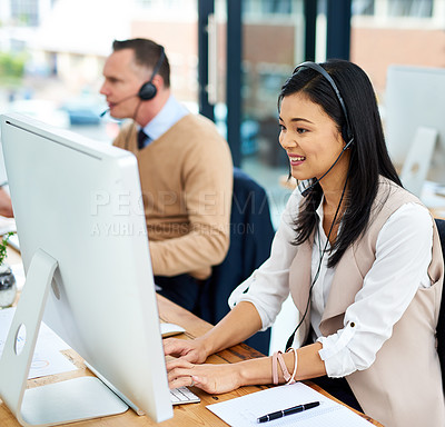 Buy stock photo Cropped shot of a young businesswoman working alongside a male colleague in the office