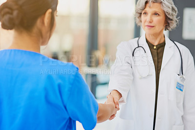 Buy stock photo Shot of a doctor and nurse shaking hands