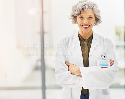 Buy stock photo Portrait of a confident and mature doctor folding her arms