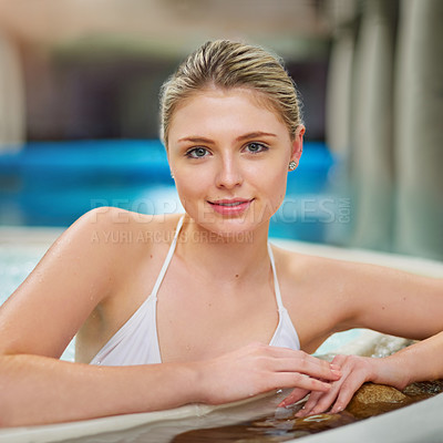 Buy stock photo Portrait of a young woman relaxing in the jacuzzi at a spa
