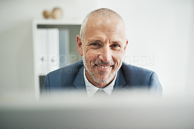 Buy stock photo Portrait of a mature businessman sitting in a modern office
