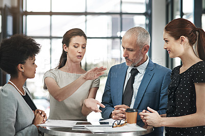 Buy stock photo Cropped shot of a group of businesspeople having a meeting in a modern office