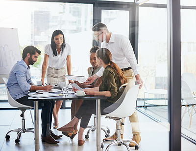 Buy stock photo Full length shot of a group of diverse businesspeople having a meeting in the boardroom