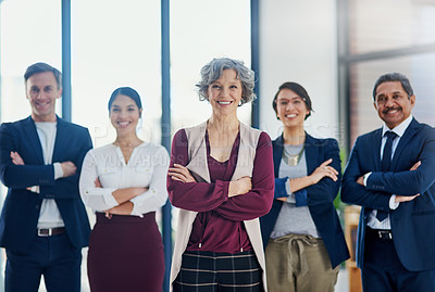 Buy stock photo Cropped portrait of a diverse group of businesspeople standing with their arms crossed in the office