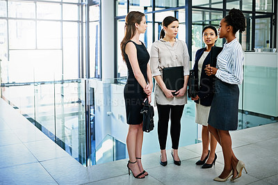 Buy stock photo Shot of businesswoman standing together while discussing business in the office