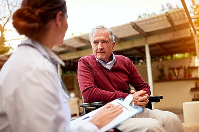 Buy stock photo Shot of a young doctor and her elderly patient talking while sitting outside