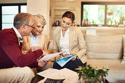 Buy stock photo Shot of a senior couple getting advice from their financial consultant