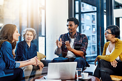 Buy stock photo Cropped shot of a group of colleagues having a meeting in a modern office